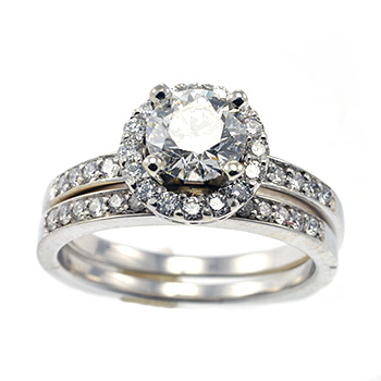 Round prong halo diamond engagement ring