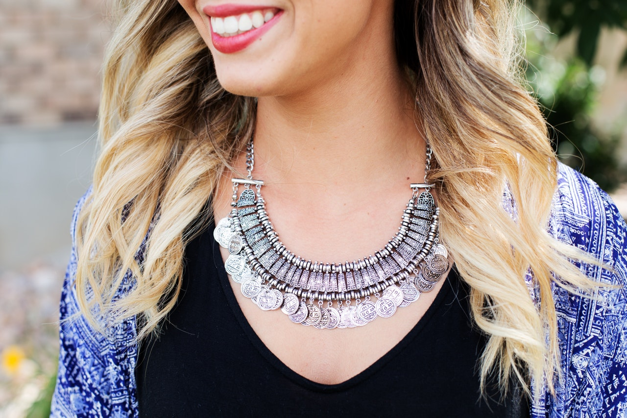 Woman wearing a custom jewelry silver necklace
