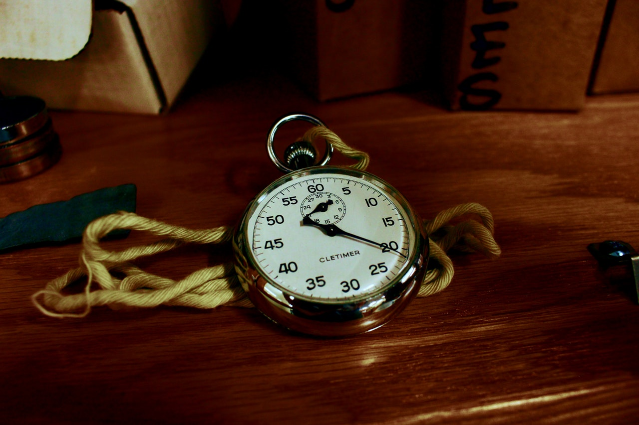 vintage watch jewelry sitting on wooden table